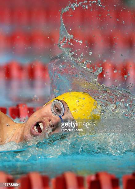 Connor Jaeger competes in the men's 400m freestyle preliminaries on day 4 of the 2013 USA Swimming Phillips 66 National Championships and World...