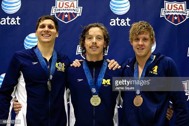 Connor Jaeger stands on the podium with his gold medal alongside second place Michael Klueh and third place Anders Nielson after winning the Men's...