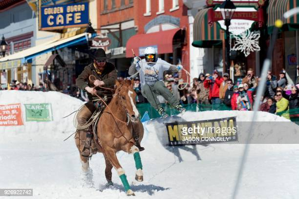 Connor James races down Harrison Avenue on his horse Plug while pulling skier Tugg Burk during the 70th annual Leadville Ski Joring weekend...
