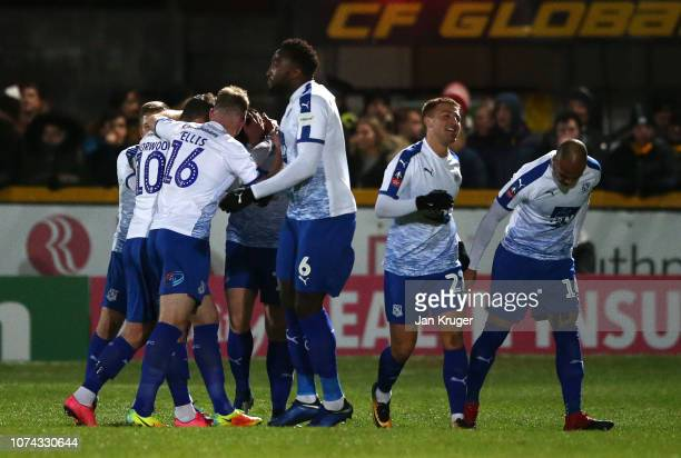 Connor Jennings of Tranmere celebrates with teammates after scoring his sides first goal during the FA Cup Second Round Replay match between...