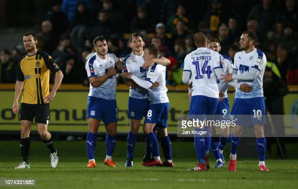 Connor Jennings of Tranmere celebrates with teammates after scoring his sides second goal during the FA Cup Second Round Replay match between...