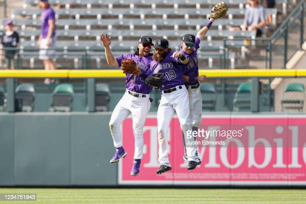 Connor Joe, Charlie Blackmon and Garrett Hampson of the Colorado Rockies celebrate a win against the San Diego Padres at Coors Field on August 18,...