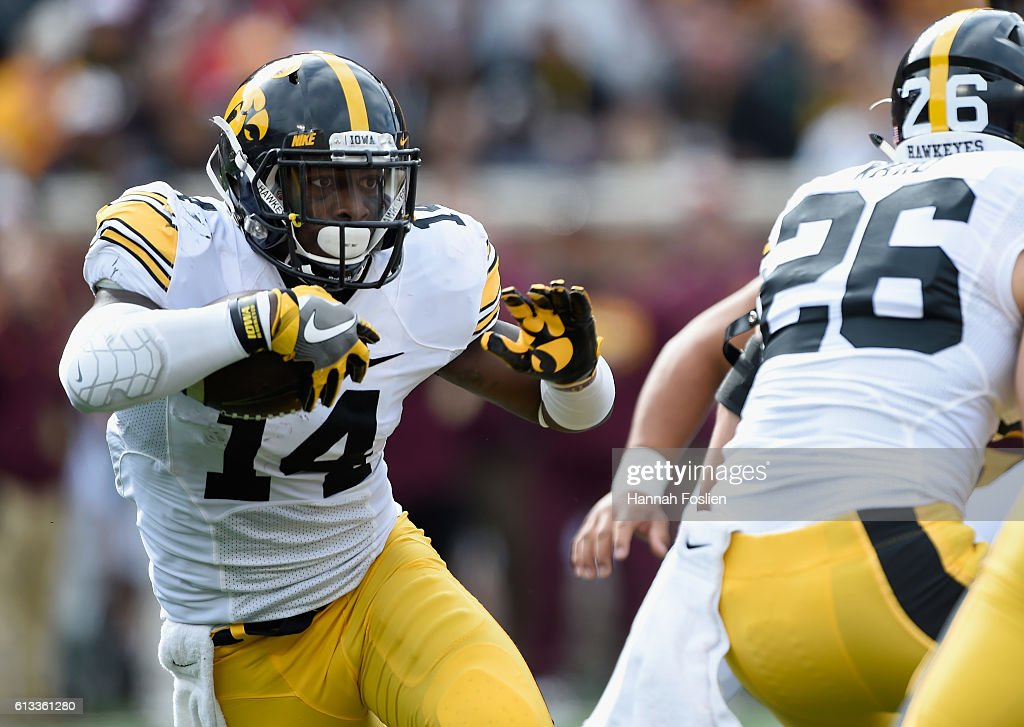 Connor Keane #14 of Iowa carries the ball against Minnesota during the second quarter of the game on October 8, 2016 at TCF Bank Stadium in Minneapolis, Minnesota.