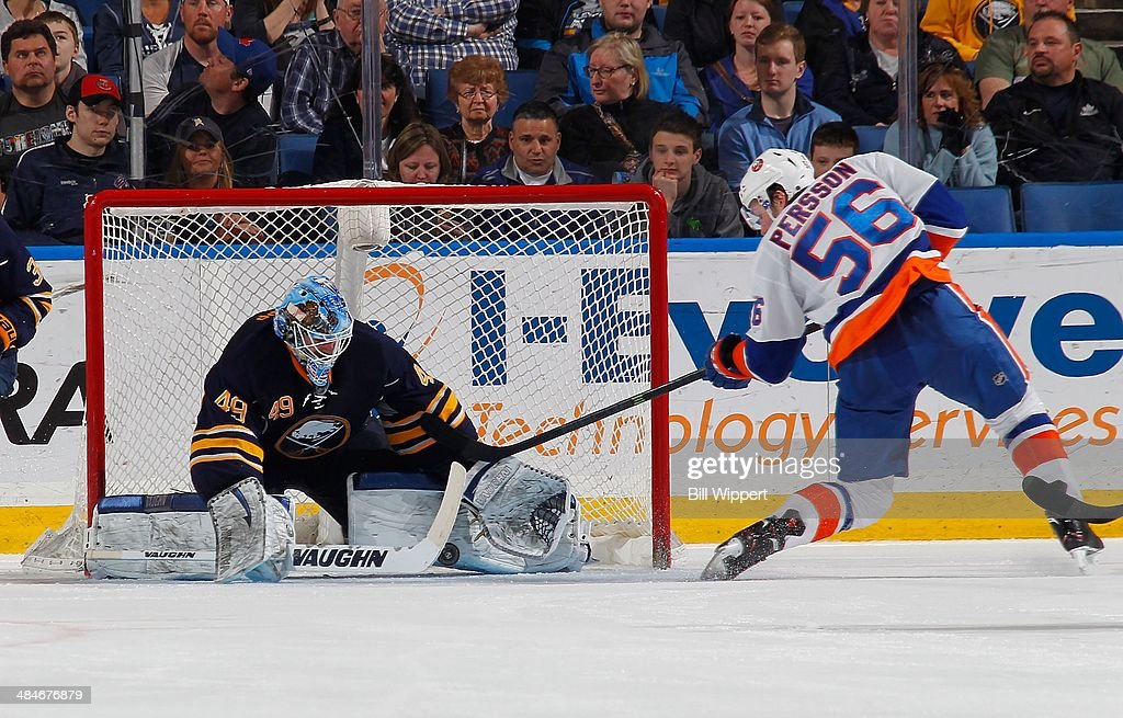 Connor Knapp #49 of the Buffalo Sabres makes a save against John Persson #56 of the New York Islanders on April 13, 2014 at the First Niagara Center in Buffalo, New York. New York won 4-3.