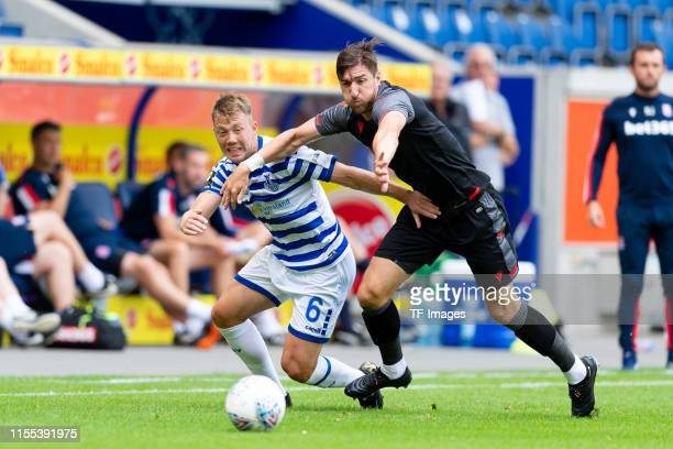 Connor Krempicki of MSV Duisburg and Stephen Ward of Stoke City battle for the ball during the preseason friendly match between MSV Duisburg and...