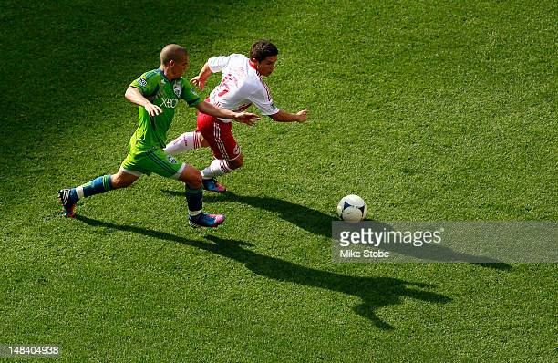 Connor Lade of the New York Red Bulls and Osvaldo Alonso of the Seattle Sounders battle for control of the ball at Red Bull Arena on July 15 2012 in...