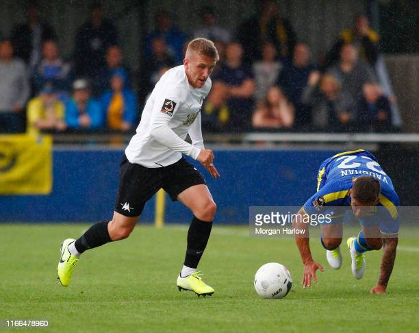 Connor LemonheighEvens of Torquay United battles for possession with Lee Vaughan of Solihull Moors during the Vanarama National League match between...