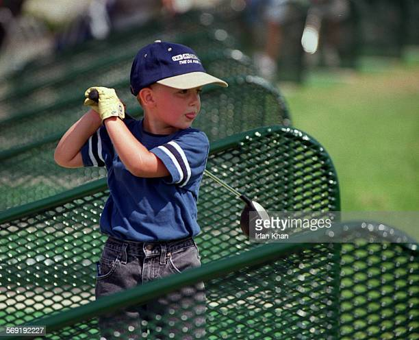 Connor Mahoney at driving range at Mile Square golf course on a Saturday morning
