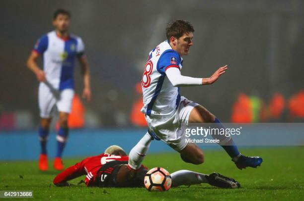 Connor Mahoney of Blackburn Rovers is challenged by Paul Pogba of Manchester United during The Emirates FA Cup Fifth Round match between Blackburn...