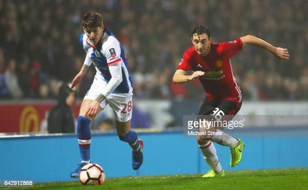 Connor Mahoney of Blackburn Rovers is chased by Matteo Darmian of Manchester United during The Emirates FA Cup Fifth Round match between Blackburn...