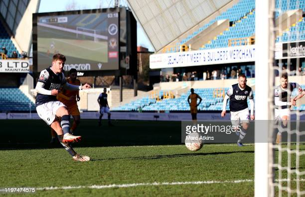 Connor Mahoney of Millwall scores his team's second goal from the penalty spot during the FA Cup Third Round match between Millwall FC and Newport...