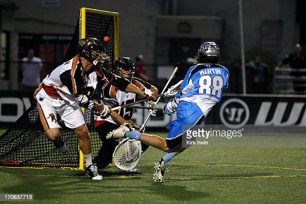 Connor Martin of the Ohio Machine beats John Galloway of the Rochester Rattlers for a goal during the third quarter on June 15 2013 at Selby Stadium...