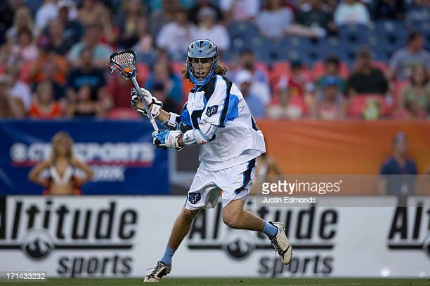 Connor Martin of the Ohio Machine in action against the Denver Outlaws at Sports Authority Field at Mile High on June 22 2013 in Denver Colorado The...