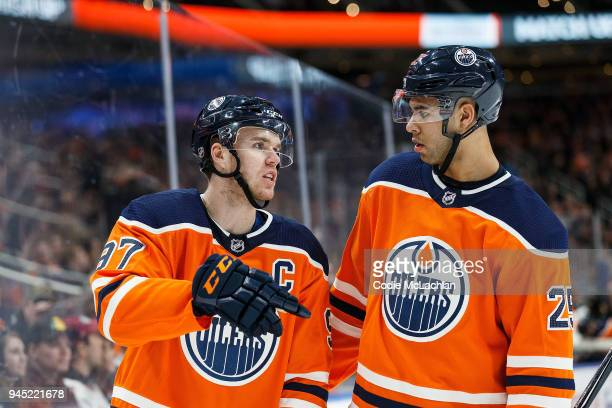 Connor McDavid and Darnell Nurse of the Edmonton Oilers strategize during a break in play against the Vegas Golden Knights at Rogers Place on April 5...
