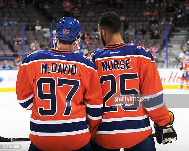 Connor McDavid and Darnell Nurse of the Edmonton Oilers warms up prior to a game against the Vancouver Canucks on April 6 2016 at Rexall Place in...