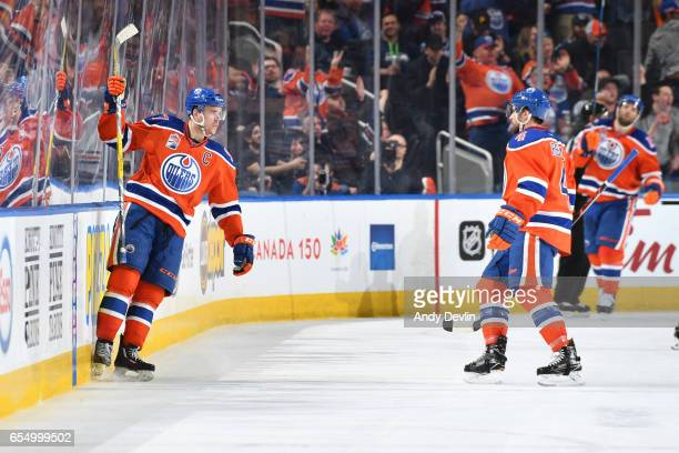 Connor McDavid and Kris Russell of the Edmonton Oilers celebrate after a goal during the game against the Vancouver Canucks on March 18 2017 at...