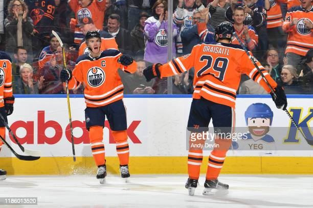 Connor McDavid and Leon Draisaitl of the Edmonton Oilers celebrate after a goal during the game against the St Louis Blues on November 6 at Rogers...