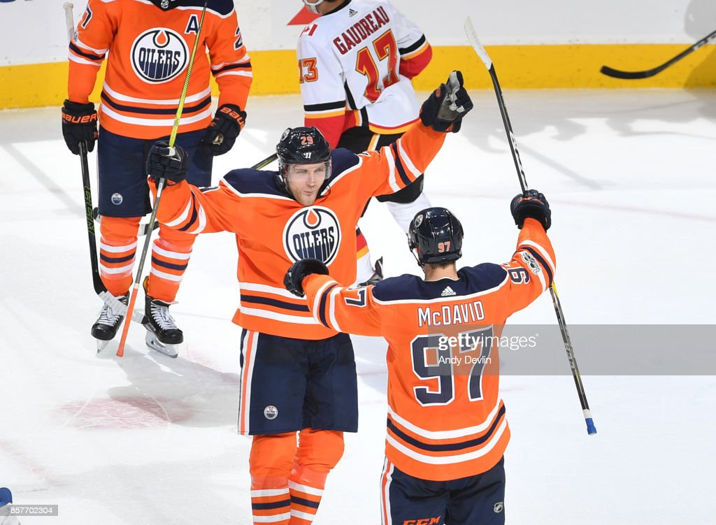 Connor McDavid #97 and Leon Draisaitl #29 of the Edmonton Oilers celebrate after a goal during the game against the Calgary Flames on October 4, 2017 at Rogers Place in Edmonton, Alberta, Canada.