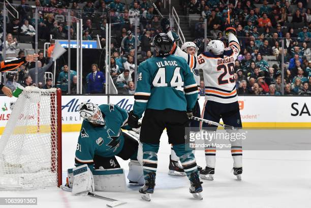 Connor McDavid and Leon Draisaitl of the Edmonton Oilers celebrate the gamewinning goal in front of Martin Jones and MarcEdouard Vlasic of the San...