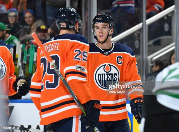 Connor McDavid and Leon Draisaitl of the Edmonton Oilers discuss the play during the game against the Dallas Stars on October 26 2017 at Rogers Place...