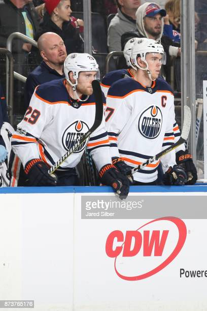 Connor McDavid and Leon Draisaitl of the Edmonton Oilers look on from the bench during the game against the New York Rangers at Madison Square Garden...