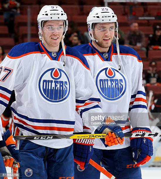 Connor McDavid and Leon Draisaitl of the Edmonton Oilers look on during warmups before the game against the Anaheim Ducks on February 26 2016 at...