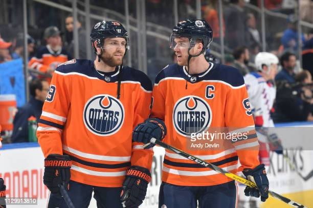 Connor McDavid and Leon Draisaitl of the Edmonton Oilers warm up prior to the game against the New York Rangers on March 11 2019 at Rogers Place in...
