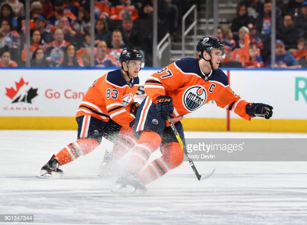 Connor McDavid and Matthew Benning of the Edmonton Oilers skate during the game against the Anaheim Ducks on January 4 2018 at Rogers Place in...