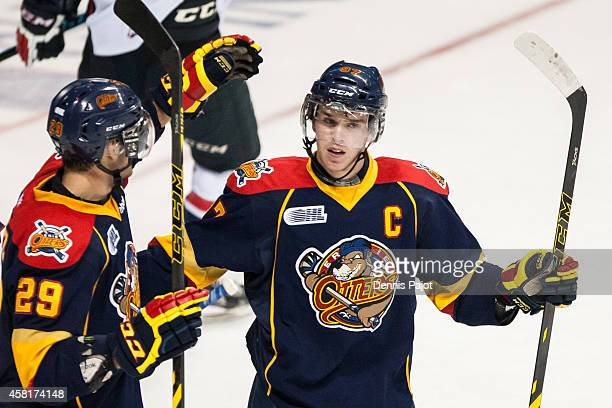 Connor McDavid and Nick Betz of the Erie Otters celebrate a goal against the Windsor Spitfires on September 26 2014 at the WFCU Centre in Windsor...