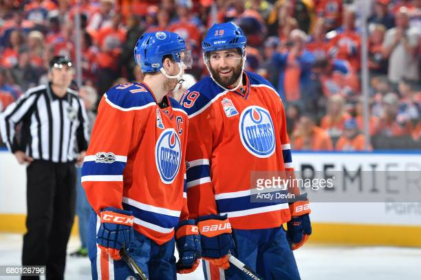 Connor McDavid and Patrick Maroon of the Edmonton Oilers discuss the play in Game Six of the Western Conference Second Round during the 2017 NHL...