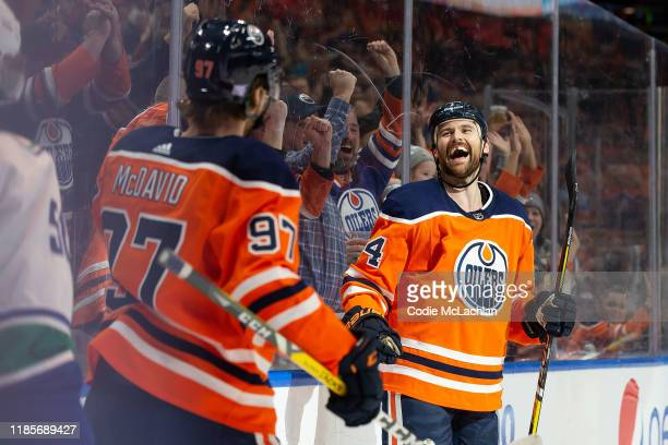 Connor McDavid and Zack Kassian of the Edmonton Oilers celebrate Kassians goal against the Vancouver Canucks at Rogers Place on November 30 2019 in...
