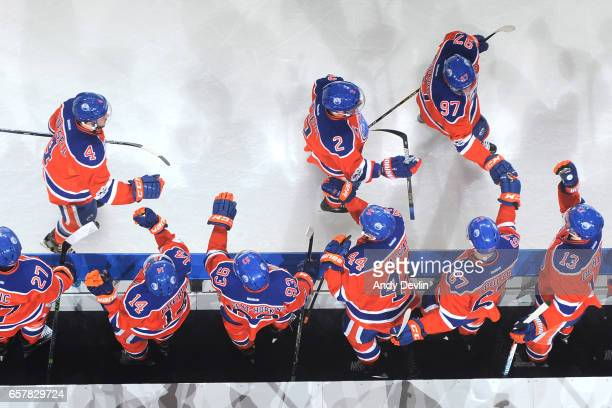 Connor McDavid Andrej Sekera and Kris Russell of the Edmonton Oilers celebrate after a goal during the game against the Colorado Avalanche on March...