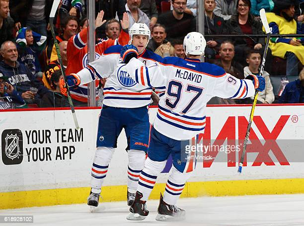 Connor McDavid congratulates Milan Lucic of the Edmonton Oilers who scored an emptynet goal against the Vancouver Canucks during their NHL game at...