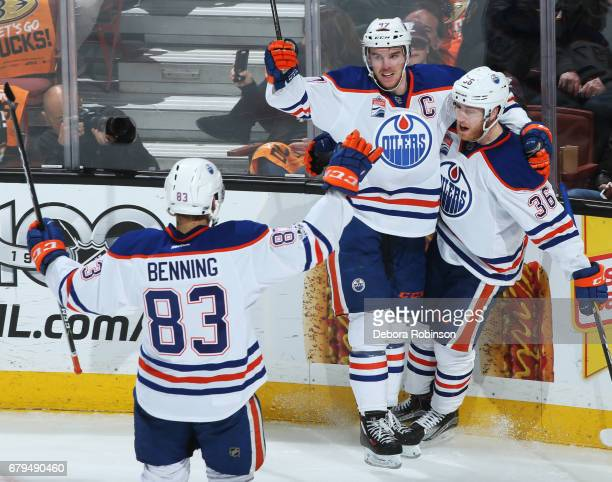 Connor McDavid Drake Caggiula and Matthew Benning of the Edmonton Oilers celebrate Caggiula's second period goal in Game Five of the Western...