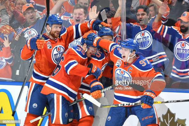 Connor McDavid Drake Caggiula Darnell Nurse and Adam Larsson of the Edmonton Oilers celebrate after a goal in Game Two of the Western Conference...