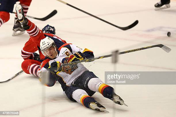 OSHAWA ON MAY 15 Connor McDavid falls to the ice after a collision with Hunter Smith as the Oshawa Generals play the Erie Otters in what may be...