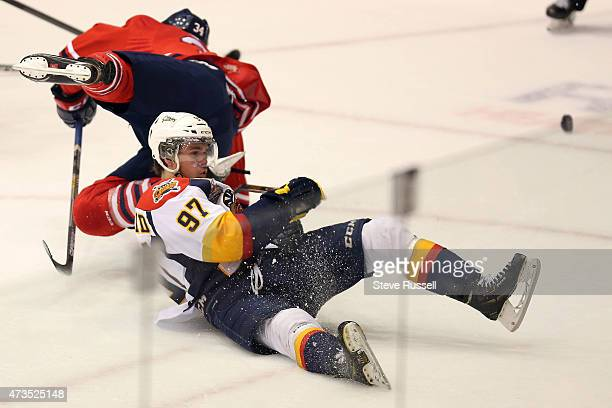 Connor McDavid falls to the ice after a collision with Hunter Smith as the Oshawa Generals play the Erie Otters in what may be Connor McDavid's, the...