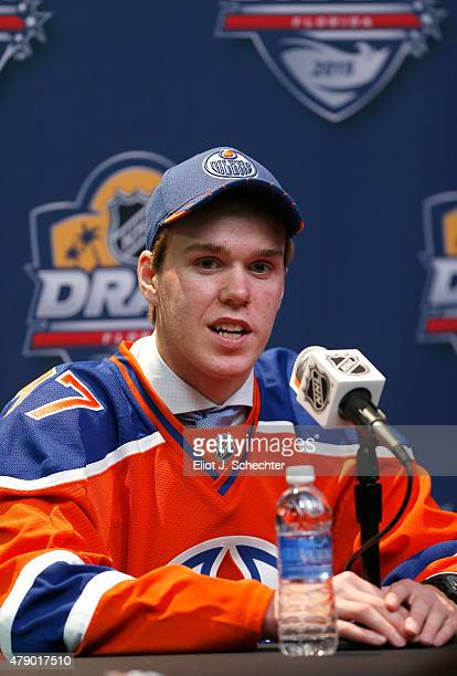 Connor McDavid is interviewed by the media after being selected first overall by the Edmonton Oilers in Round One of the 2015 NHL Draft at BBT Center...