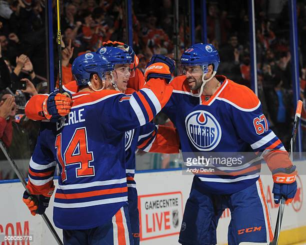 Connor McDavid Jordan Eberle and Benoit Pouliot of the Edmonton Oilers celebrate after a goal during a game against the Columbus Blue Jackets on...