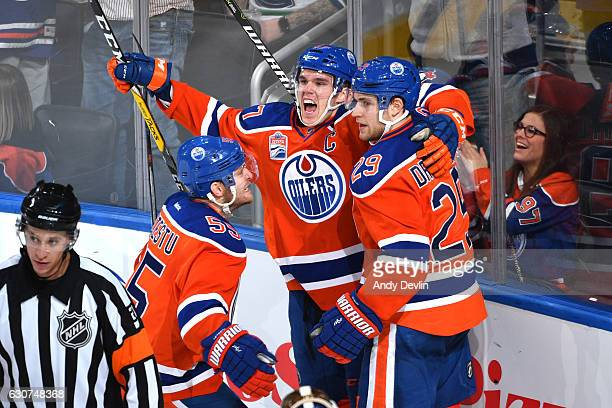 Connor McDavid Leon Draisaitl and Mark Letestu of the Edmonton Oilers celebrate after a goal during the game against the Vancouver Canucks on...