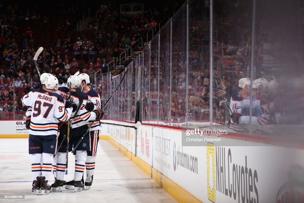 Connor McDavid #97, Leon Draisaitl #29, Darnell Nurse #25 and Patrick Maroon #19 of the Edmonton Oilers celebrate after Nurse scored a goal against the Arizona Coyotes during the third period of the NHL game at Gila River Arena on January 12, 2018 in Glendale, Arizona. The Oilers defeated the Coyotes 4-2.