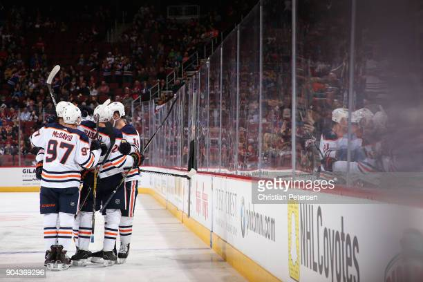 Connor McDavid Leon Draisaitl Darnell Nurse and Patrick Maroon of the Edmonton Oilers celebrate after Nurse scored a goal against the Arizona Coyotes...