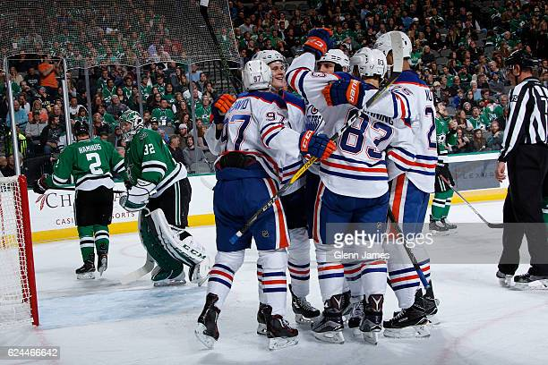 Connor McDavid Matthew Benning Darnell Nurse and the Edmonton Oilers celebrate a goal against the Dallas Stars at the American Airlines Center on...