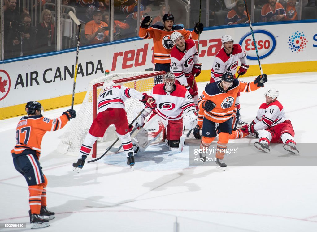 Connor McDavid #97, Milan Lucic #27 and Mark Letestu #55 of the Edmonton Oilers celebrate Letestu's goal on goaltender Cam Ward #30 of the Carolina Hurricanes as Carolina's Jaccob Slavin #74, Brett Pesce #22, Elias Lindholm #28 and Jordan Staal #11 react on October 17, 2017 at Rogers Place in Edmonton, Alberta, Canada.