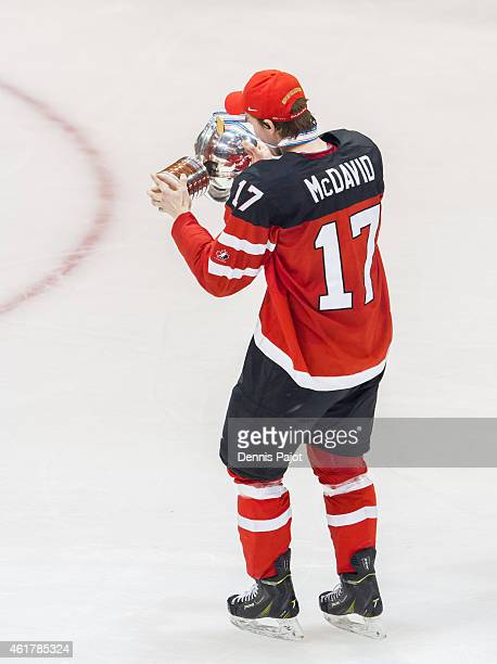 Connor McDavid of Canada celebrates with the trophy after a 54 win against Russia during the Gold medal game of the 2015 IIHF World Junior...
