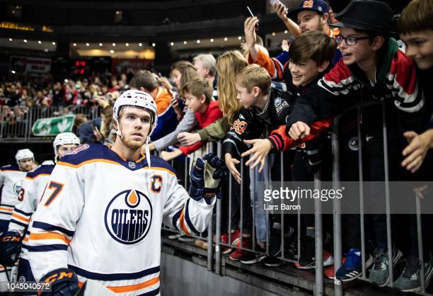Connor McDavid of Edmonton shakes hands with the fans prior to the NHL Global Series Challenge game between Edmonton Oilers and Kolner Haie at...