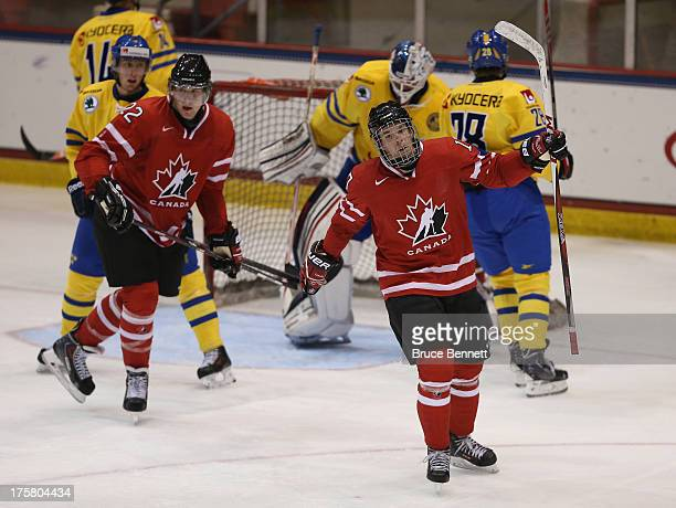 Connor McDavid of Team Canada celebrates his powerplay goal at 4:11 of the second period against Team Sweden during the 2013 USA Hockey Junior...