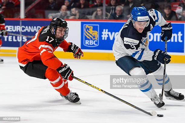 Connor McDavid of Team Canada follows Julius Honka of Team Finland during the 2015 IIHF World Junior Hockey Championship game at the Bell Centre on...