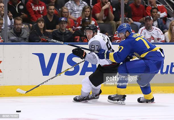 Connor McDavid of Team North America battles for a loose puck with Victor Hedman of Team Sweden during the World Cup of Hockey 2016 at Air Canada...