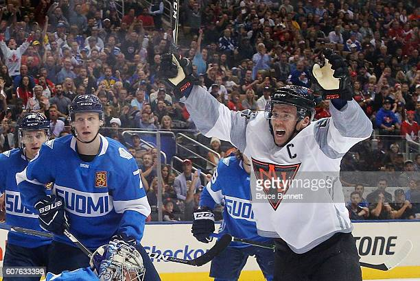 Connor McDavid of Team North America celebrates a first period goal by Jack Eichel against Team Finland during the World Cup of Hockey tournament at...